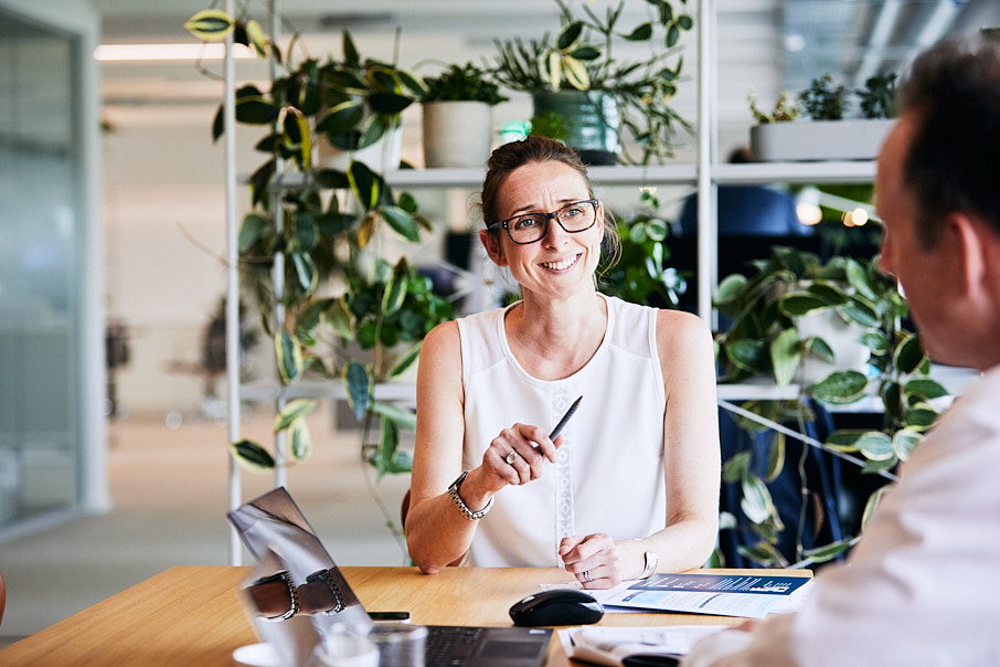 Image of business women in modern office with plants in background