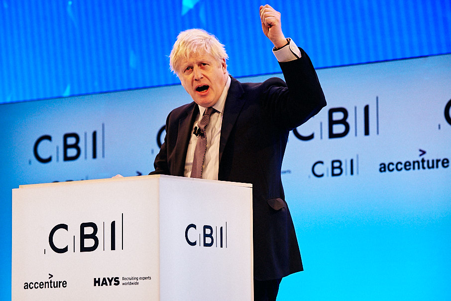 Boris Johnson at CBI conference with fist in air