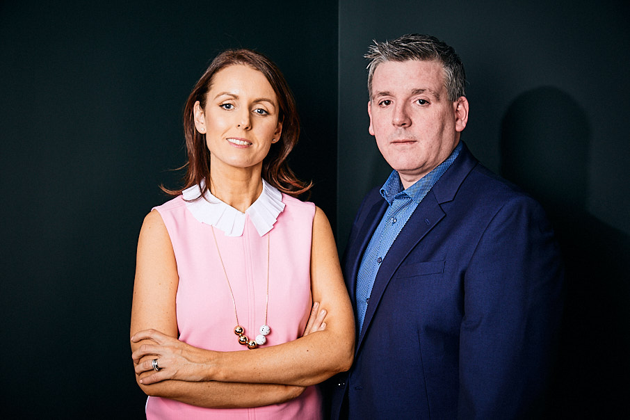 Shot of male and female business people against a black background