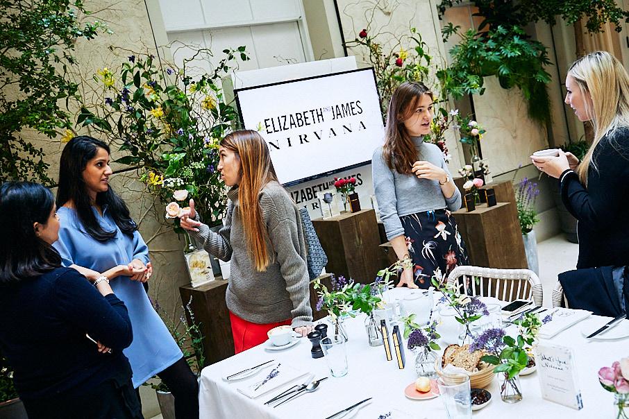 Women enjoying Elizabeth and James press launch event