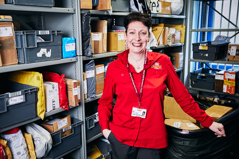 Female post office worker in the mailroom
