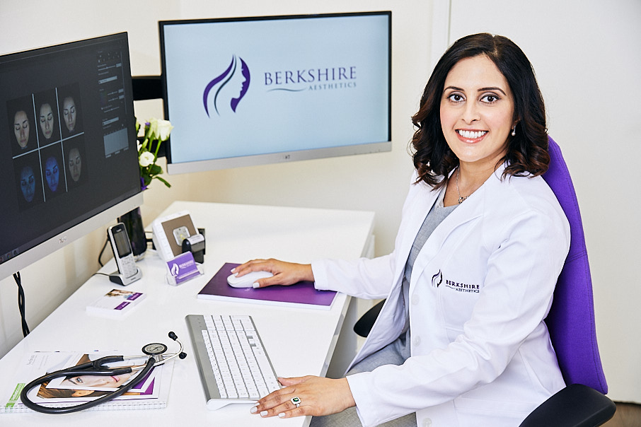 Personal branding photography of female therapist at desk