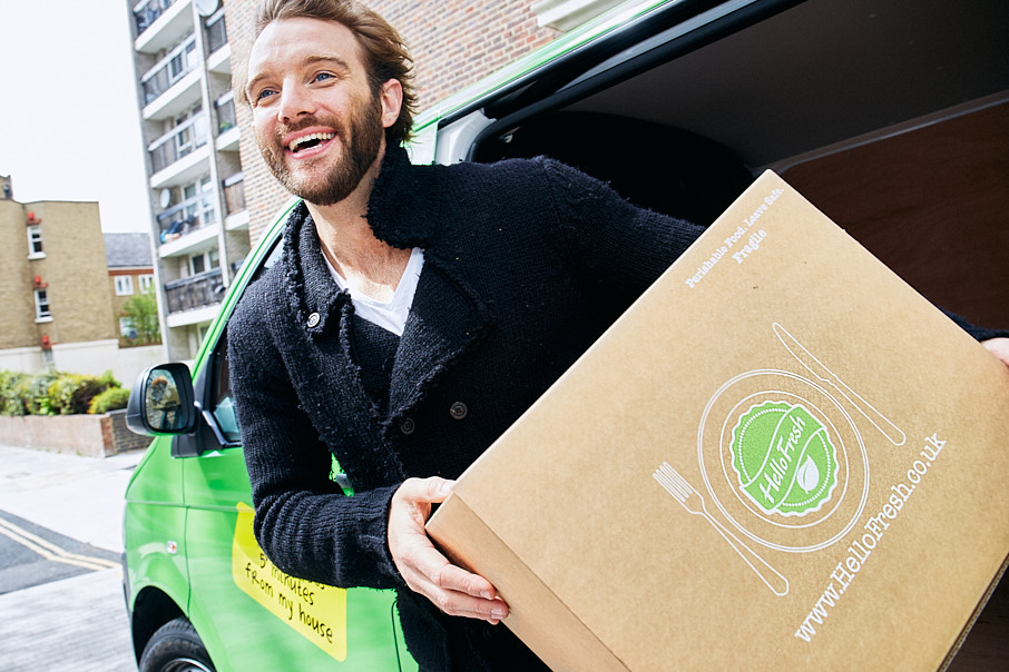 image of man delivering Hello Fresh in a green van