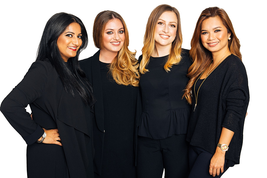 4 stylish women dressed in black
