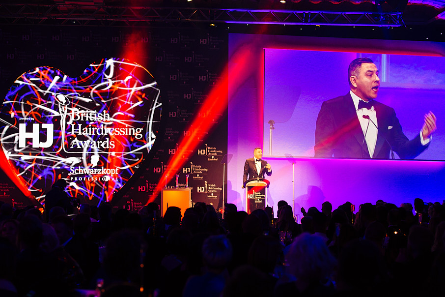 David Walliams presenting on stage at event