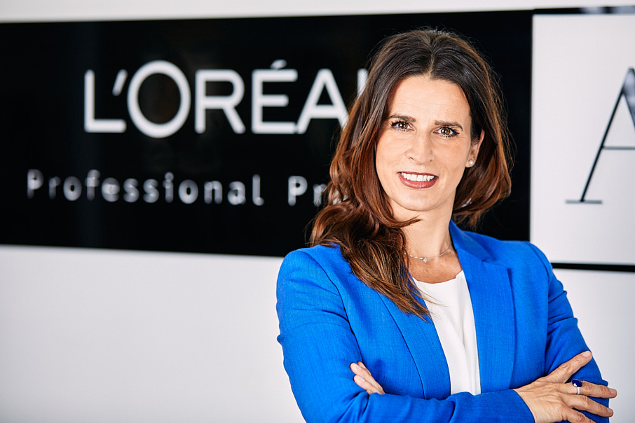 Business headshot of corporate woman in blue jacket