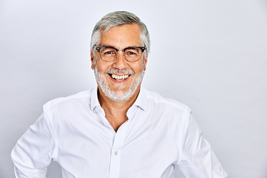 business headshot of a man in white shirt