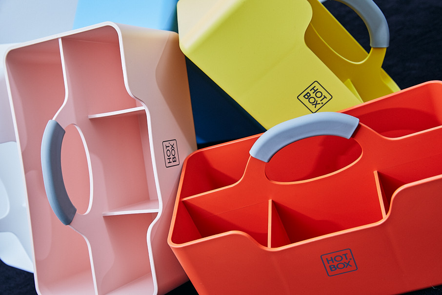 Colourful desk tidy containers in pink, yellow and red