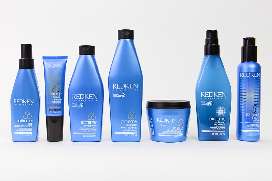 Redken hair products lined up against a white background