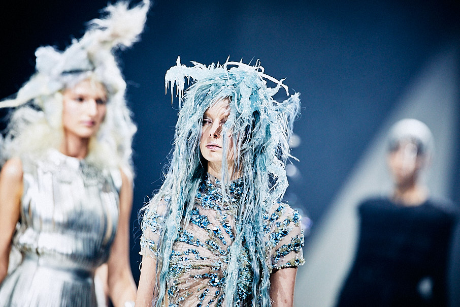 Toni & Guy female hair models dressed in metallic blue and silver on stage with dramatic hair