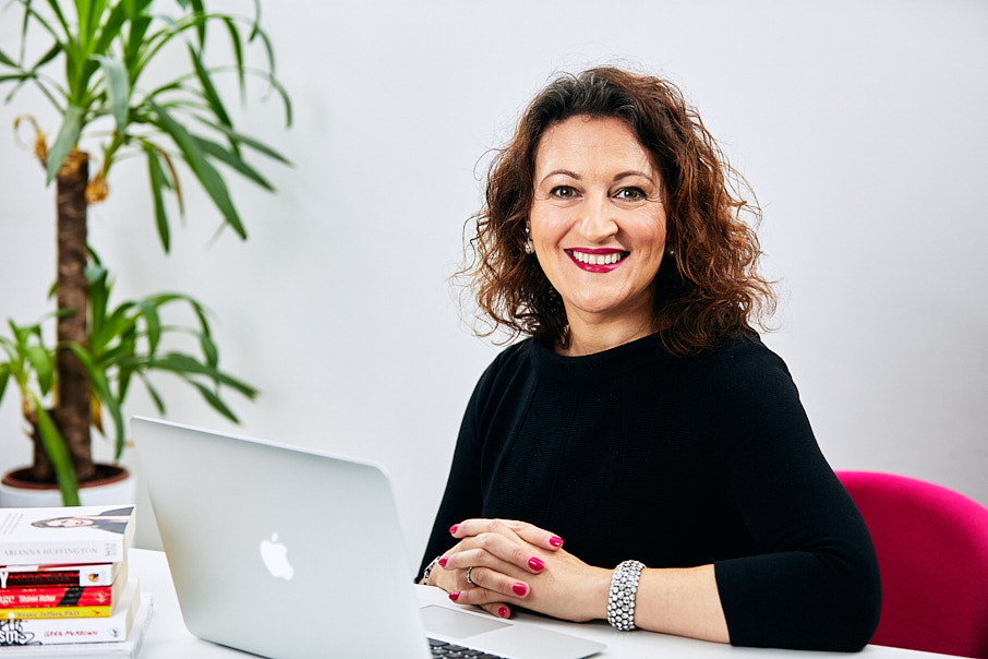 Personal branding photography of woman at desk