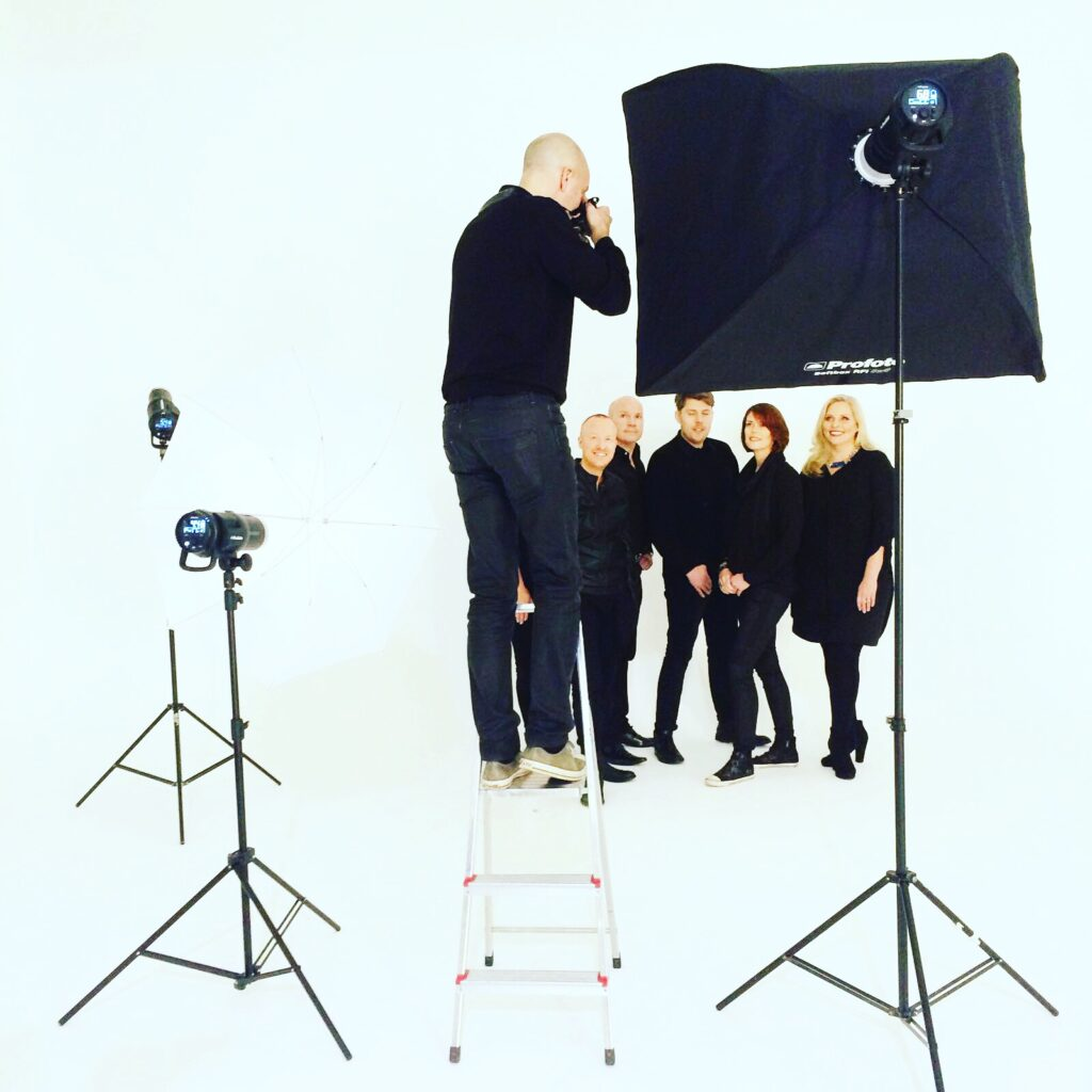 Photographer in a studio photographing corporate portraits