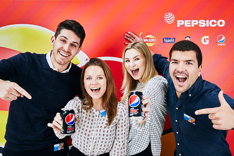 Pepsico staff smiling with products