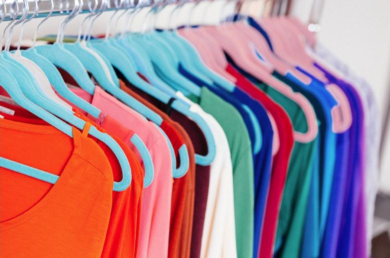 Coloured clothes on a rail